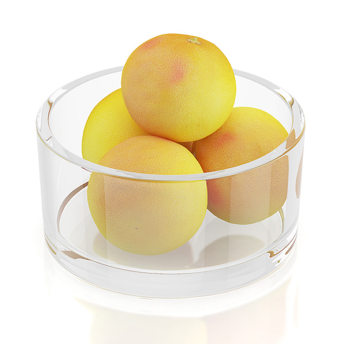Grapefruits in glass bowl